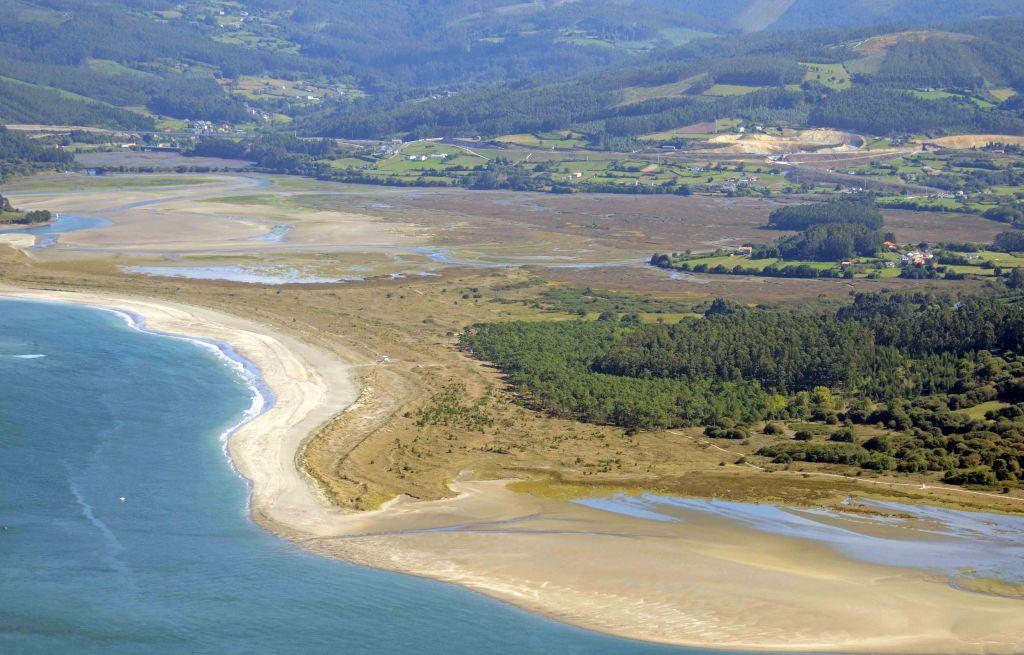 Morouzos beach (Playa) showing the salt marsh, sand dunes and pines behind the beach